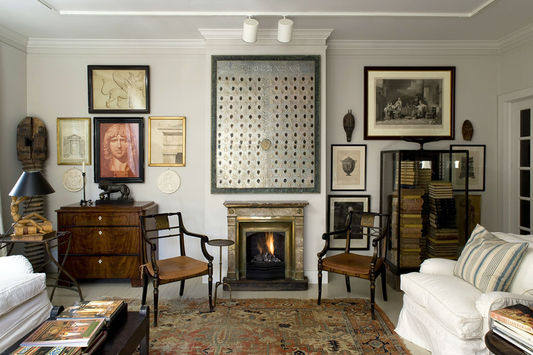 Chairs either side of fireplace in traditional style sitting room