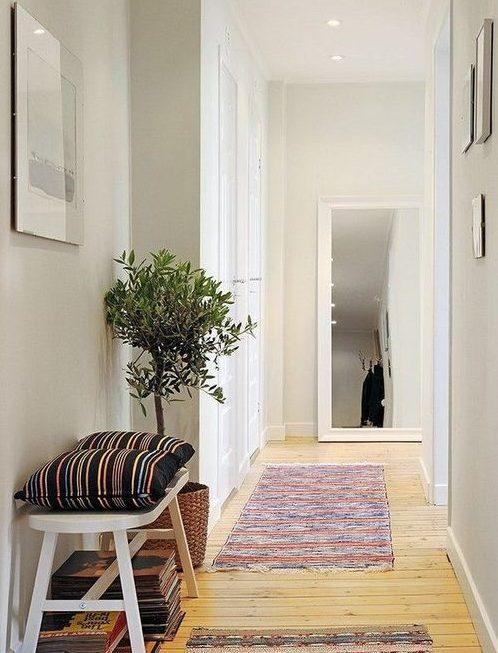 Decoraci n pasillos y recibidores consejos de iluminaci n for Decoracion pasillos